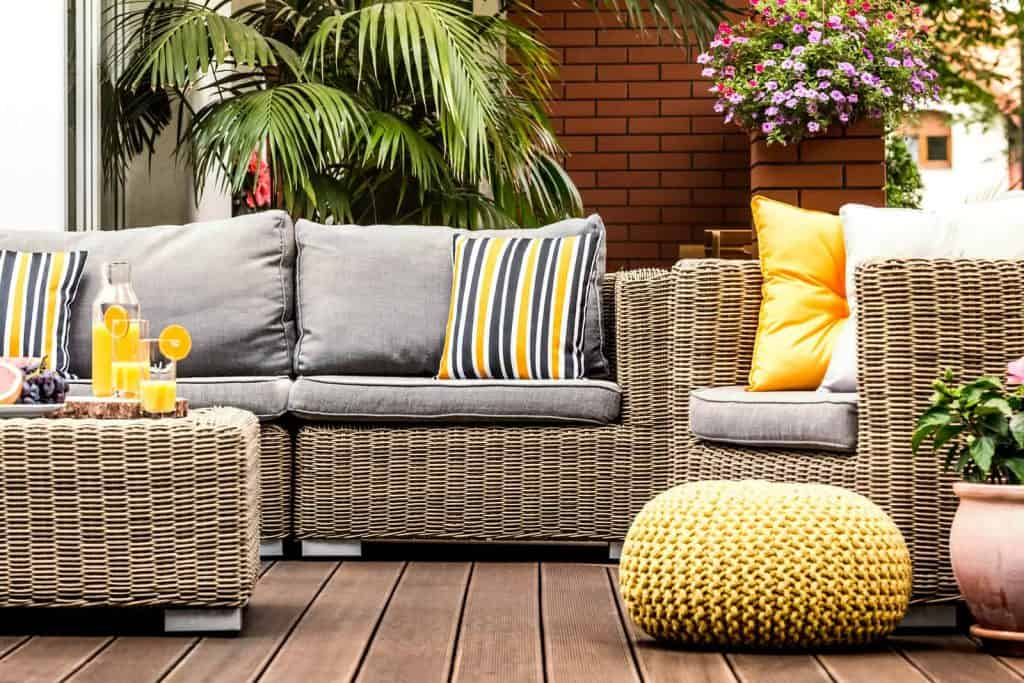 Outdoor garden furniture with striped throw pillows for summer decor