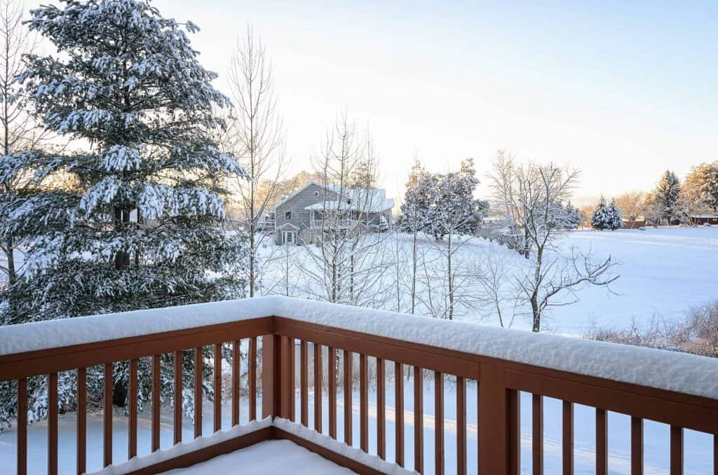 View from backyard wood deck with everything in sight covered in snow
