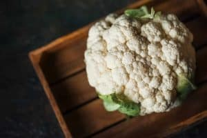 Cauliflower on wooden board, cleaned and ready for cooking