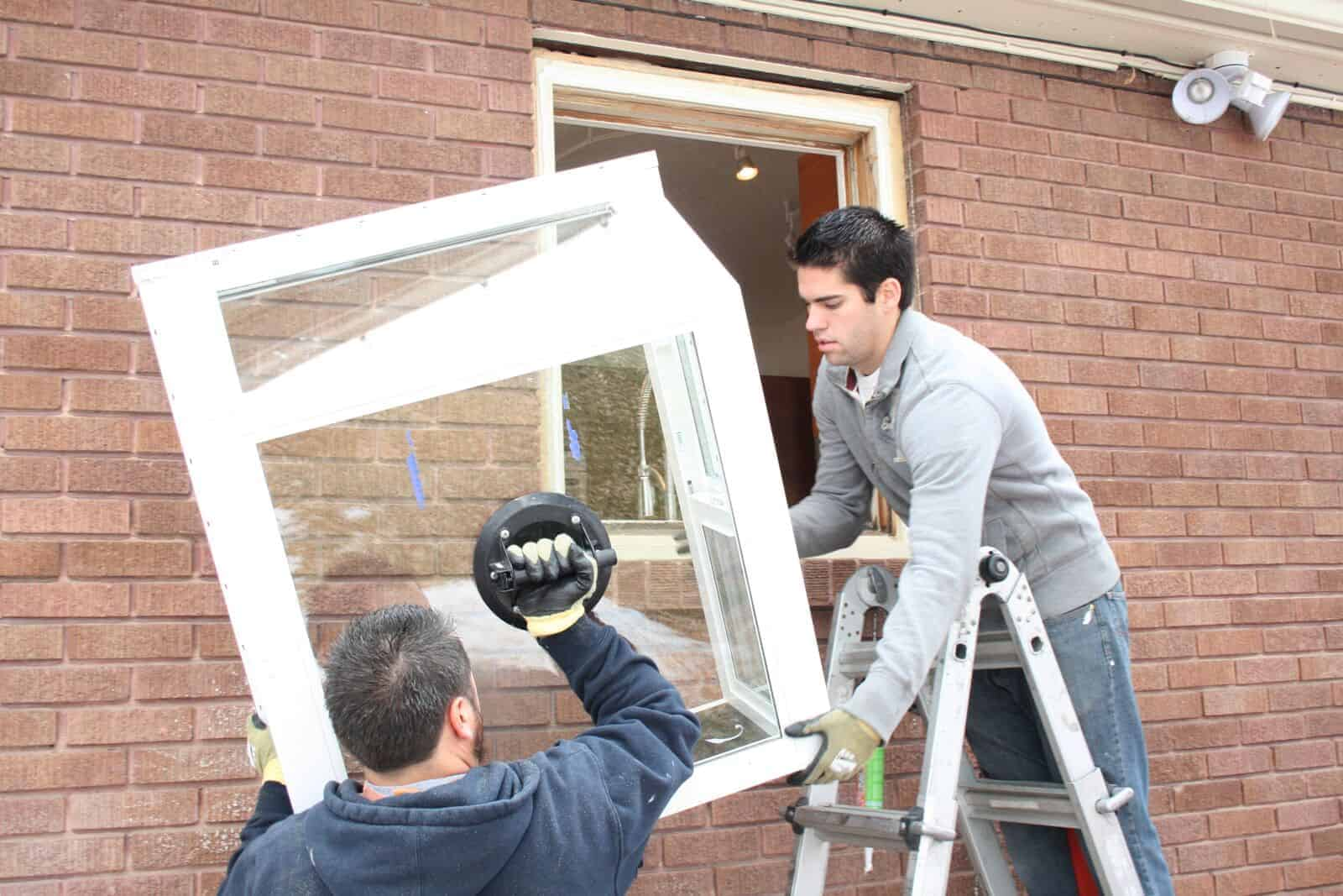 Jones Paint & Glass windows installers replace old house window in Utah residential home