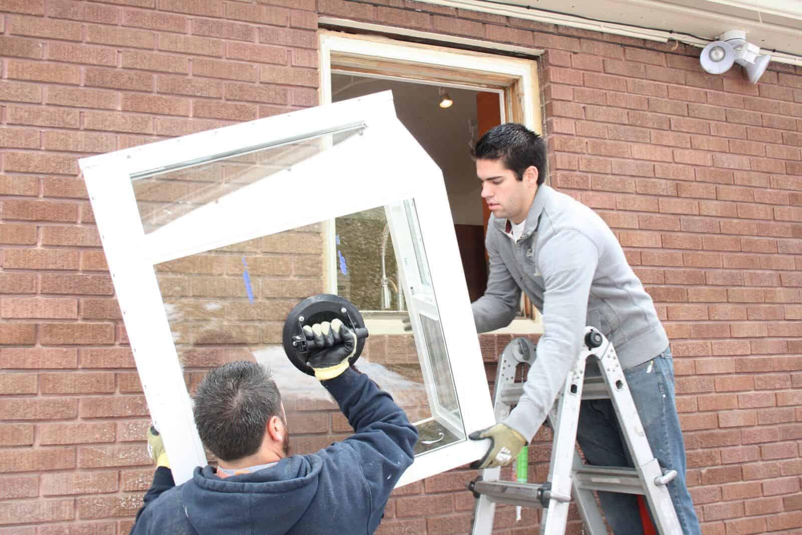 Jones Paint & Glass windows installers replace old house window in Utah residential home