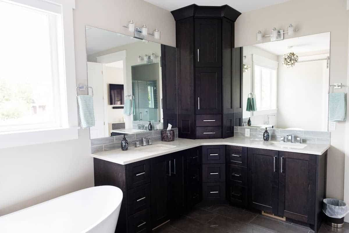 Bathroom redesign includes custom glass mirrors and cabinets painted with black interior paint