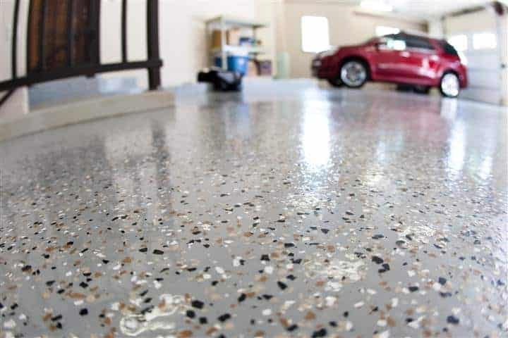 Speckled garage epoxy coating inside a residential garage