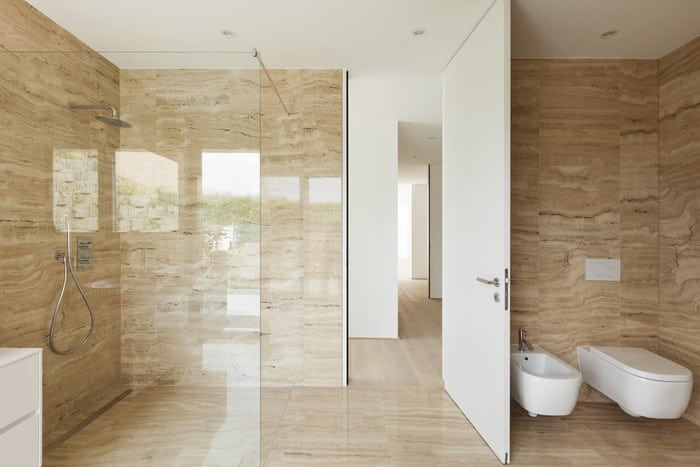 Euro glass shower doors give a remodeled bathroom a feel of luxury