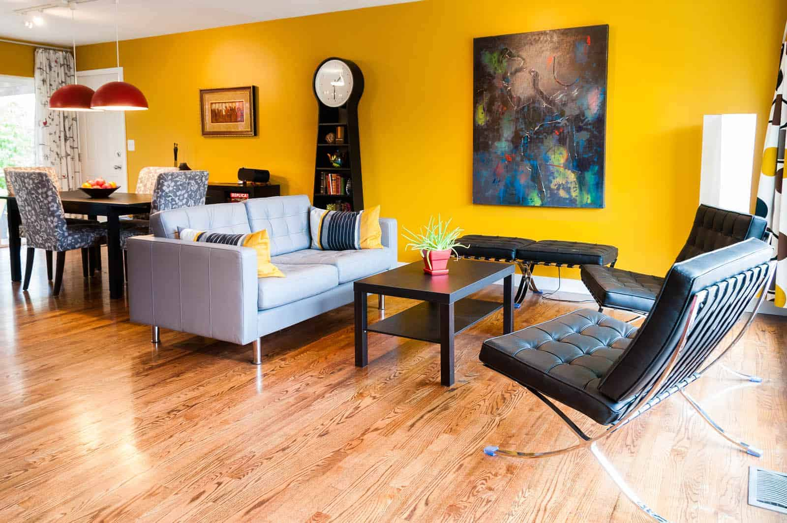 Bright yellow interior paint color on dining and living room wall