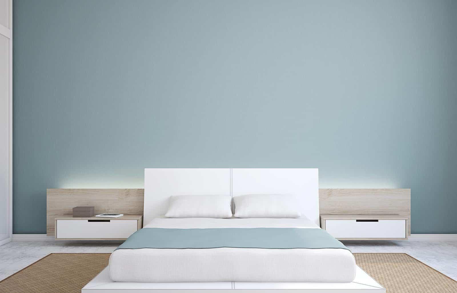 Light blue interior painted walls in minimalist bedroom