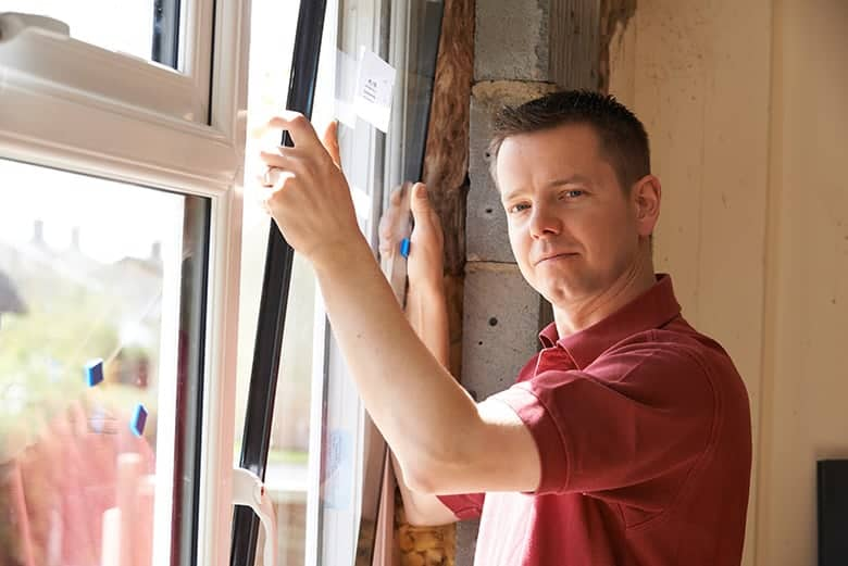 Residential windows installer adjusting new replacement windows