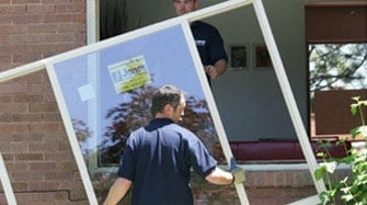 New replacement house windows being installed by Jones Paint & Glass