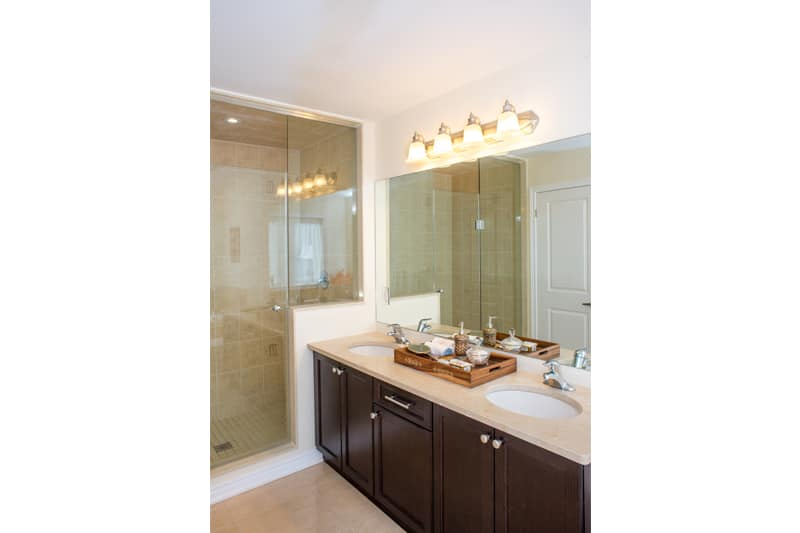 Luxury master bathroom with long counter.
