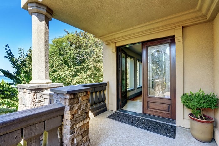Open front entry door with decorative glass design