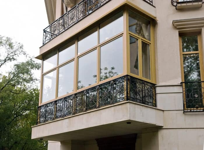 Fiberglass windows enclose balcony in urban residence