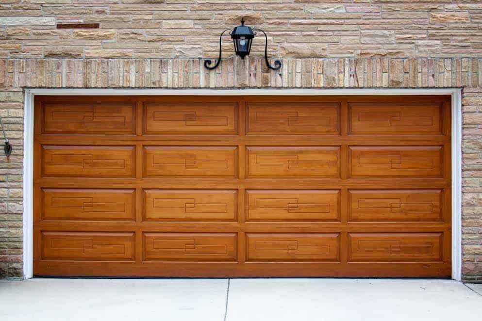 Wood garage door with custom designed panels