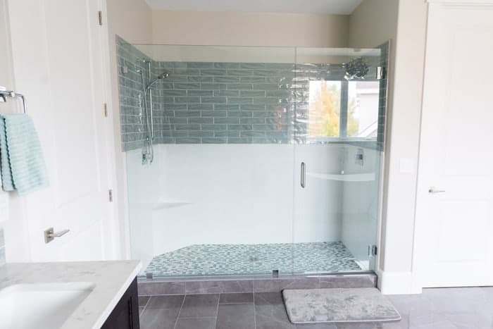 Frameless shower glass doors in renovated bathroom