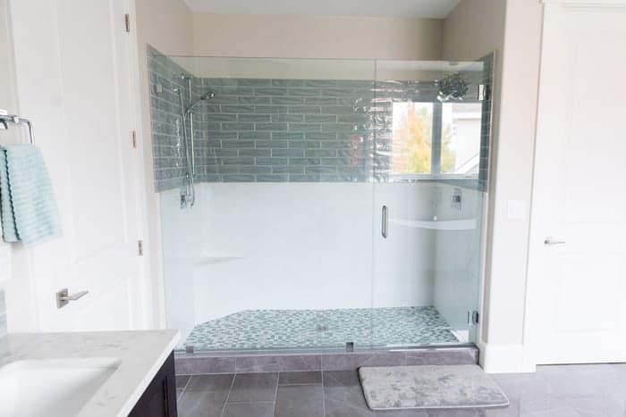 Frameless shower glass doors in renovated bathroom