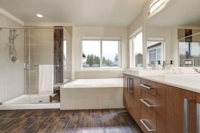 New shower glass install for walk-in shower in modern bathroom