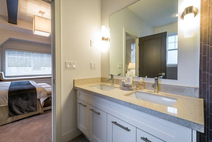 Custom mirror above double sink in residential bathroom