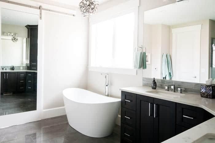 Custom vanity mirrors and full length mirror on opposite wall