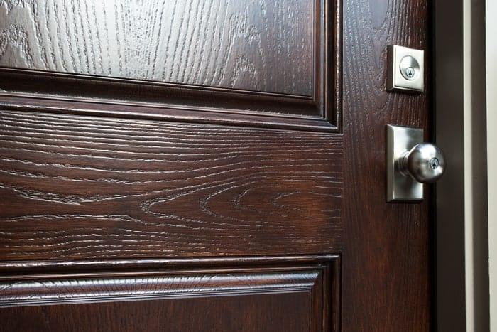 Wood exterior door with stainless steel lock and doorknob