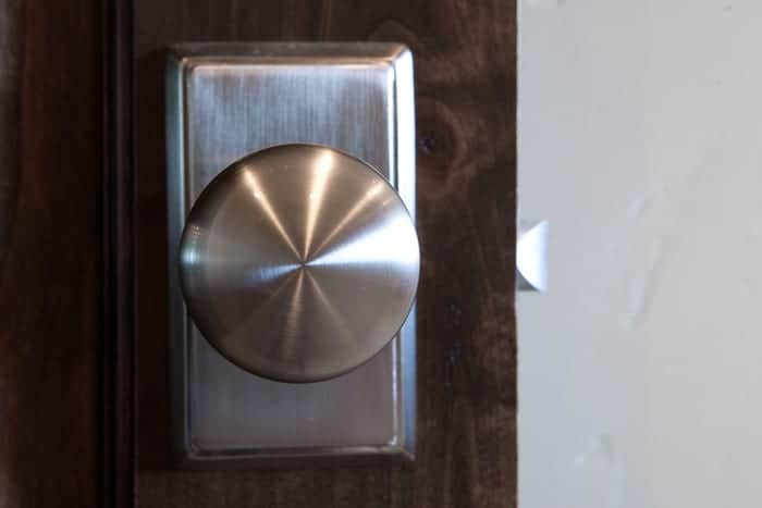 Closeup of stainless steel doorknob on exterior door