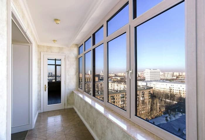 Row of fiberglass windows give view to urban skyline from inside apartment
