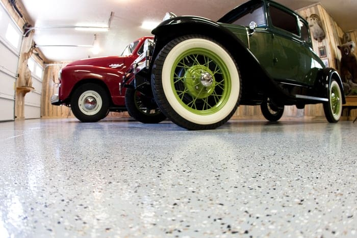Garage epoxy floor coating applied to residential garage where two vintage cars are stored