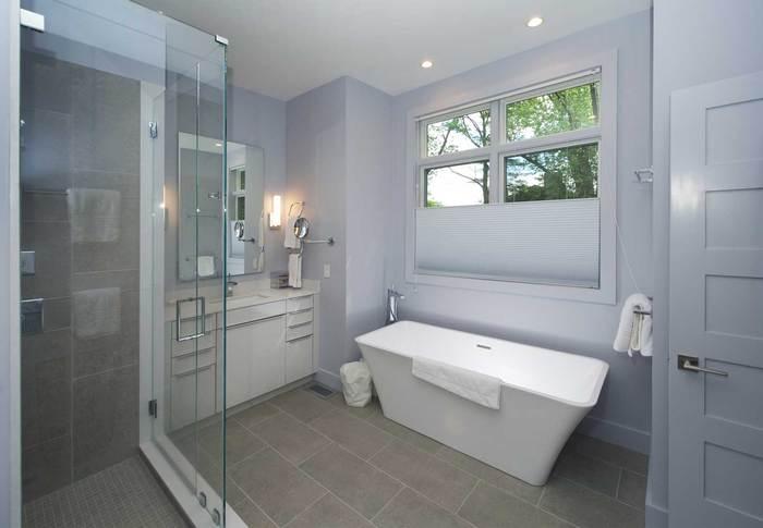 Bathroom with new glass shower doors and modern bathtub