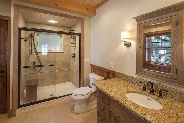 Provo Utah home bathroom with custom vanity mirror and sliding shower glass doors