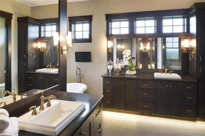 Custom vanity mirrors on opposite walls in luxury bathroom