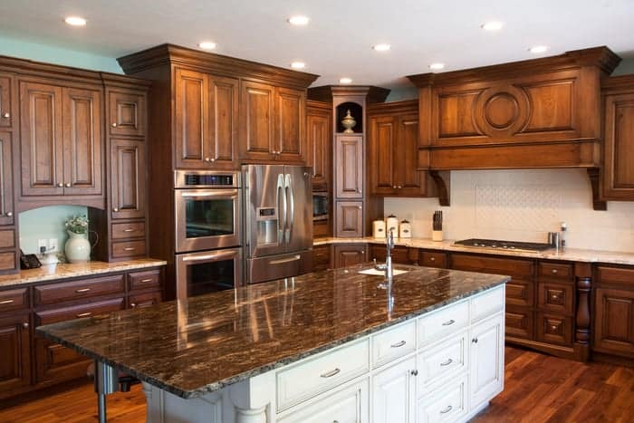 Dark mahogany wood stain and finish gives renovated kitchen a look of luxury
