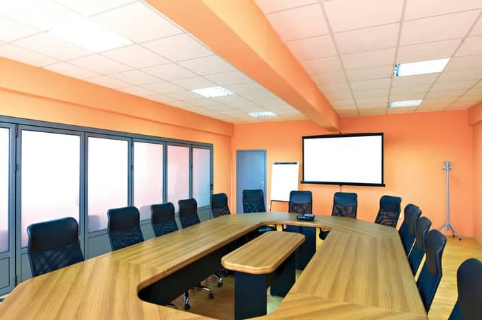 Commercial conference room with projector and frosted commercial glass windows for privacy