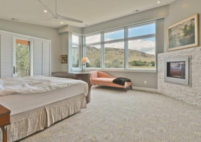 Replacement windows in master bedroom look out over mountain edge