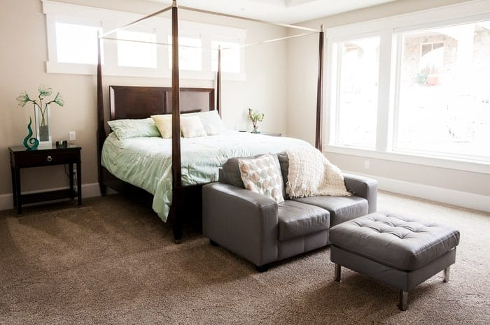 Master bedroom with large house windows that light the room