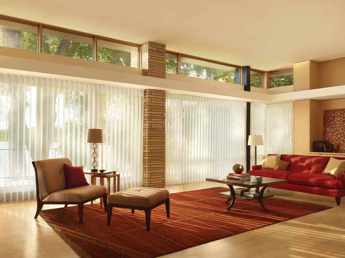 Vertical blinds covering floor-to-ceiling living room windows