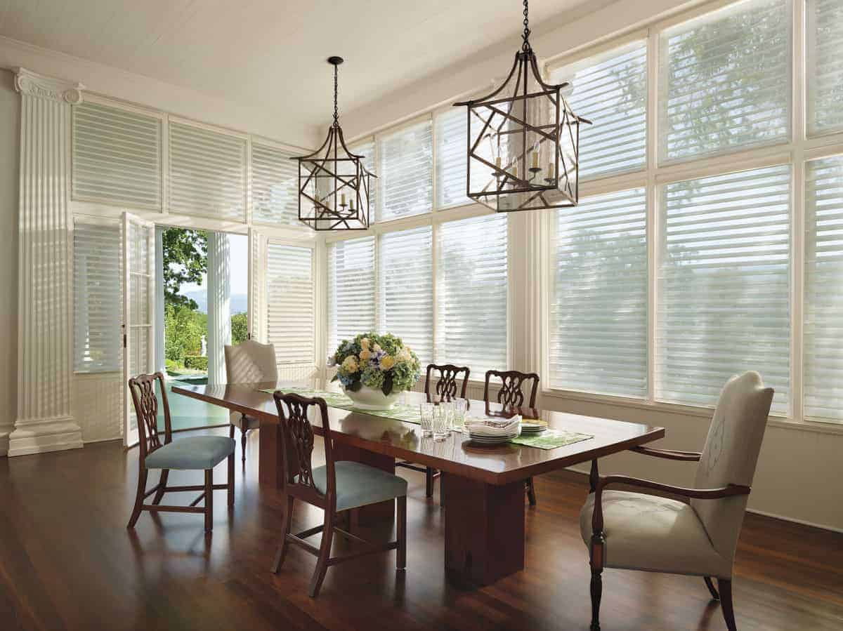 Dining room windows covered by plastic window treatments