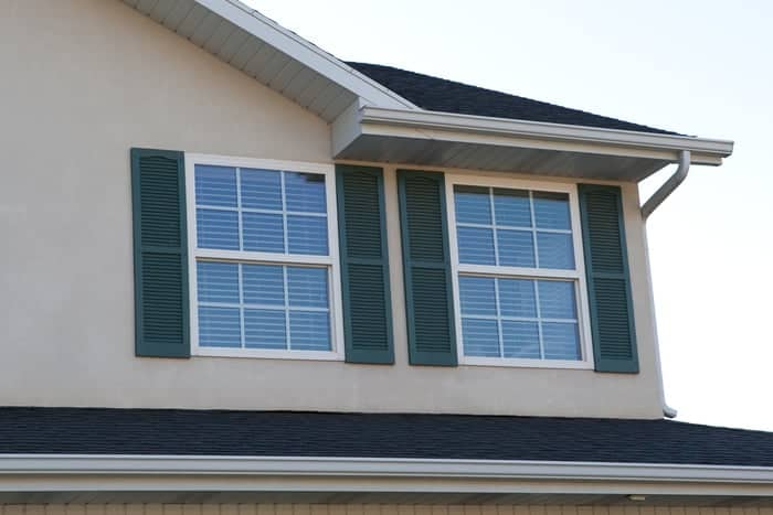 Vinyl house windows side by side