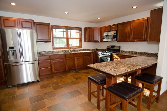 Renovated kitchen with wood windows above the sink to match wood cabinets