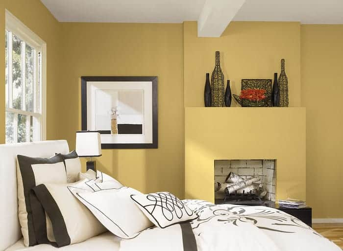 Bedroom with golden yellow interior painted walls