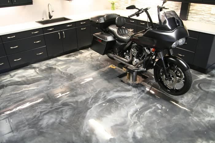 Residential garage floor coating with motorcycle and work space
