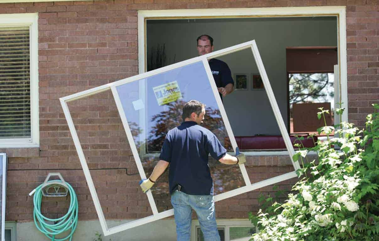 Provo Utah windows installers carry a new house window into place