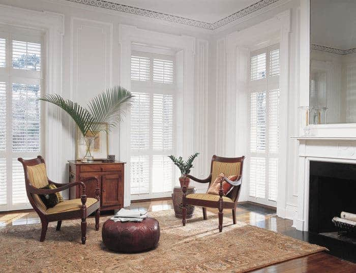 White plantation shutters are the window coverings in Provo Utah home's sitting area