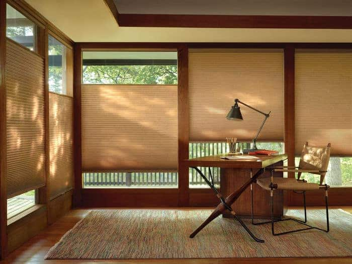 Adjustable window shades on several floor-to-ceiling wooden windows