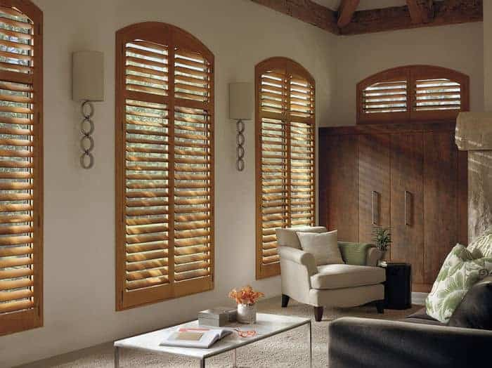 Wood window treatments offer luxury look for living room window coverings