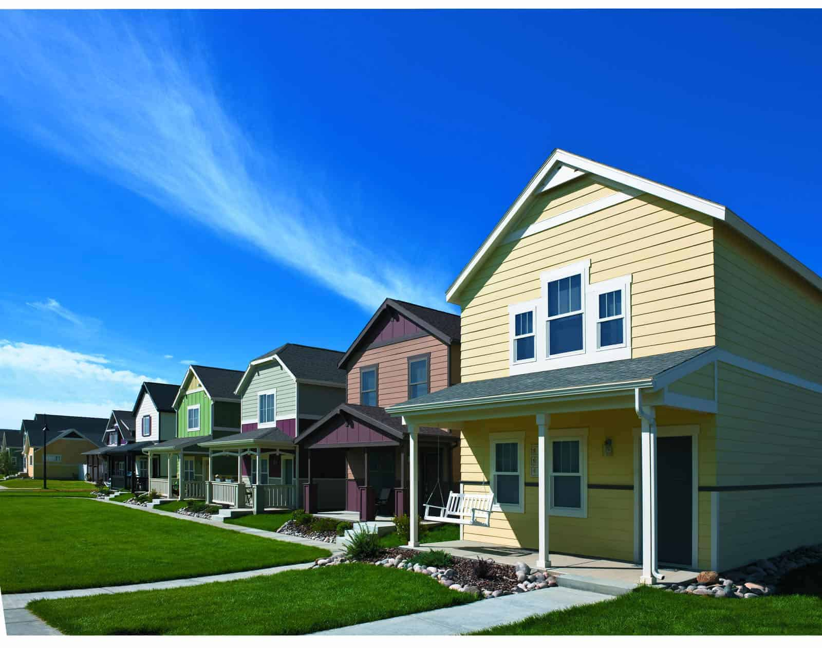 Row of colorful houses with fiberglass and composite windows