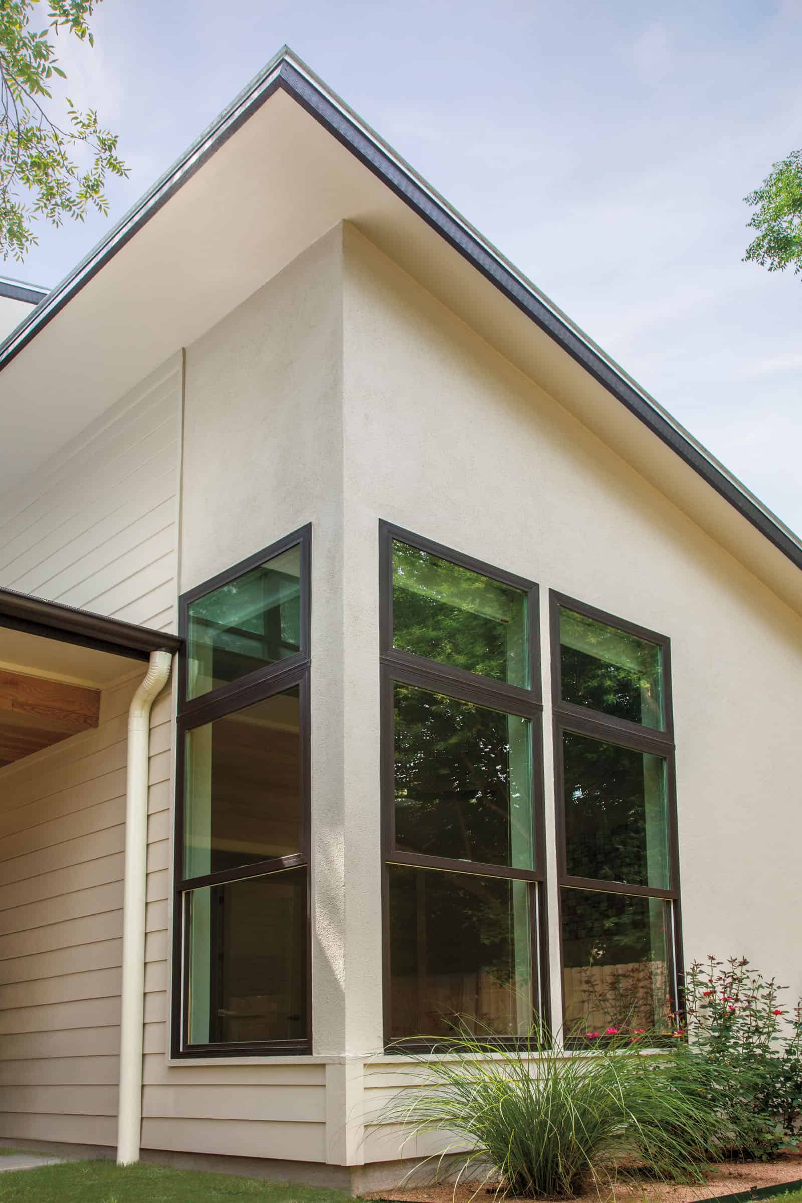 Exterior of fiberglass and composite windows on the corner of modern residential house