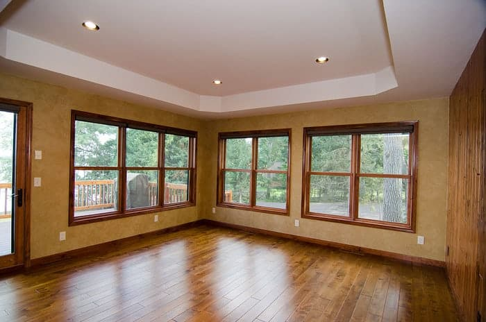 Utah mountain home has some of the best wood windows installed in renovated living room giving view to outside