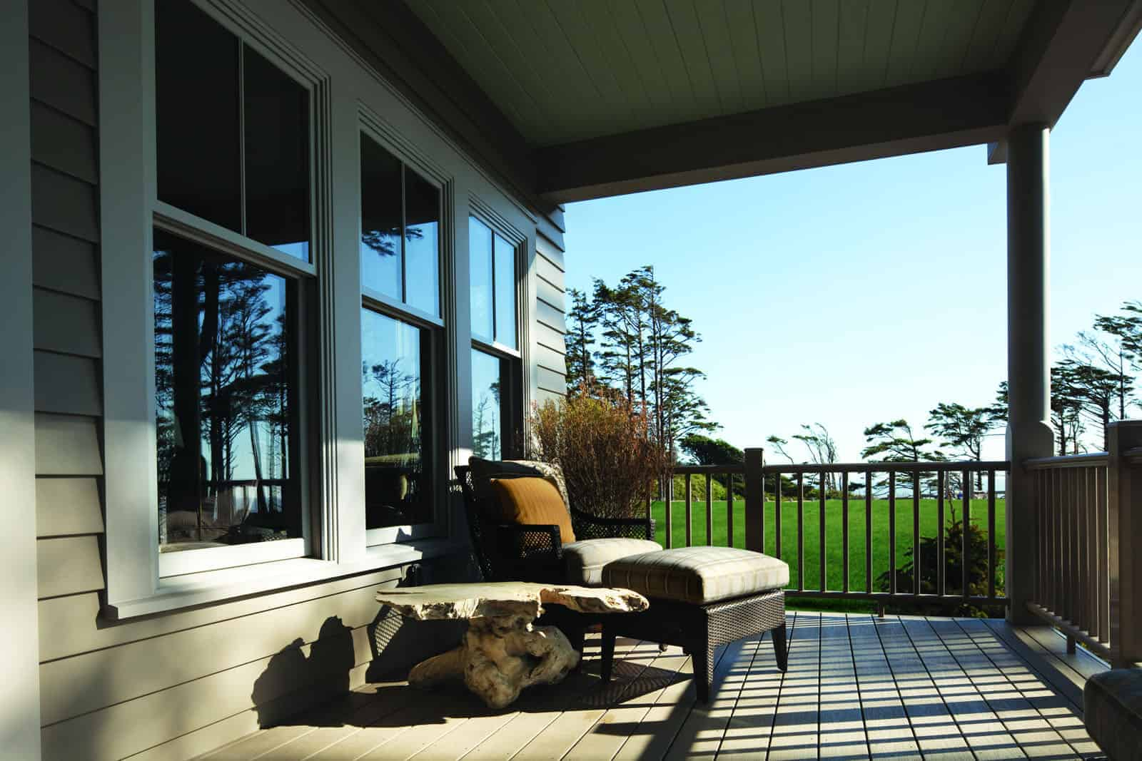 Wood windows look out to wraparound porch