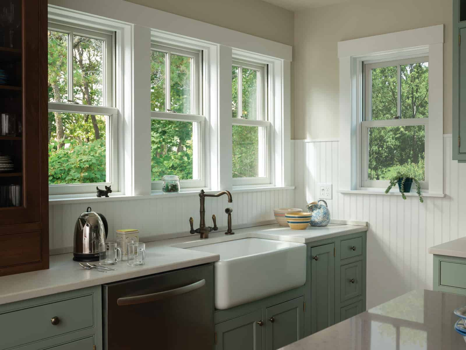 Some of the best wood windows from Jones Paint & Glass are installed above kitchen sink in Utah home