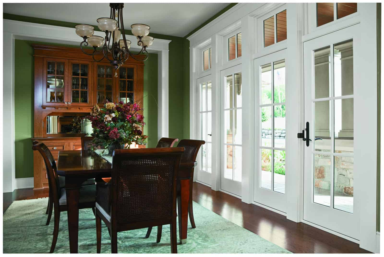 Wood windows and glass patio doors lead into remodeled dining room
