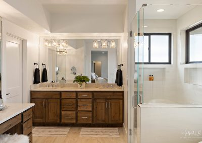 Bathroom mirrors and shower glass in luxury Utah home