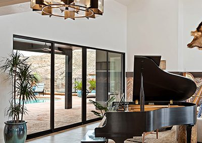 Expansive Patio Doors Behind Grand Piano in Utah Home by Jones Paint and Glass